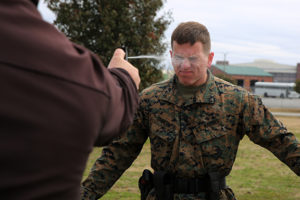 Lance Cpl. Dakota Jankowski gets sprayed with Oleoresin Capsicum, a potent pepper spray-like chemical during an obstacle course at Marine Corps Air Station Cherry Point, N.C, March 6, 2015. Marines with the Provost Marshal's Office must complete the obstacle course while under the effects of OC spray in order to pass the exercise. Jankowski is a student in the block training course for PMO guards and a native of Camano Isle, Wash.