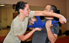 Senior Airman Shealyn Storm, 352nd Special Operations Support Squadron, attempts to disarm Capt. Daniel Dittrich, 352nd Special Operations Maintenance Squadron, using a long-gun takeaway technique she learned during a Krav Maga class. The class, once only offered to the members of the 352nd SOSS, is now open to all members of the 352nd Special Operations Group. The class is taught by trained instructors assigned to the 352nd SOG's security forces flight.